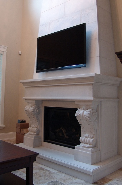 Limestone fireplace mantel with over mantel